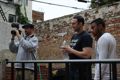 Beatboxers Amit (right) and Grey Matter (middle) wait their turn to be interviewed by Pascal Tessaud (left)