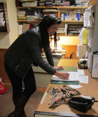 Tiffany Lim working in the First Church Shelter Office