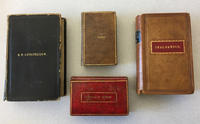 Four psalm and hymn books with names of former owners in gold on their covers