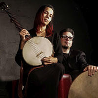 Photo of Rhiannon Giddens with Francesco Turrisi from presenter Global Arts Live