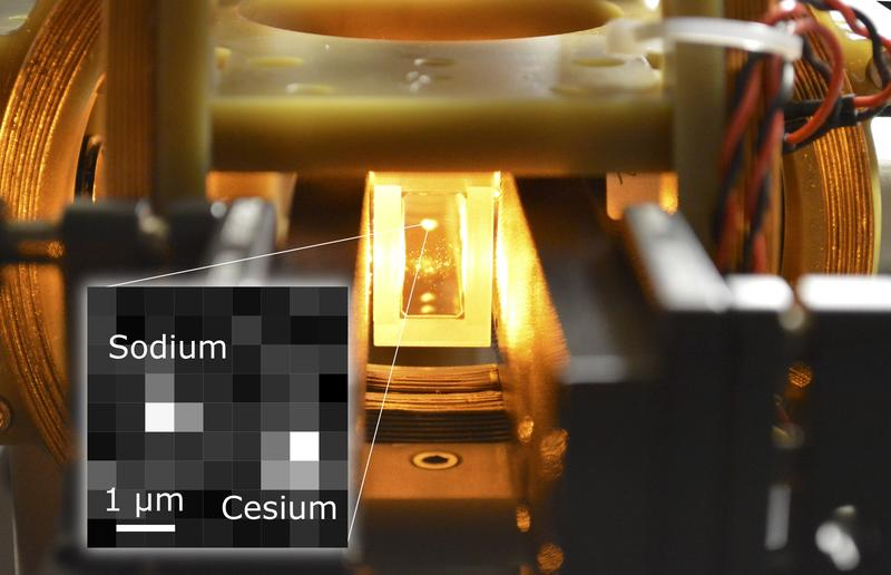 A laser-cooled cloud of a million sodium atoms suspended inside a glass cell vacuum apparatus