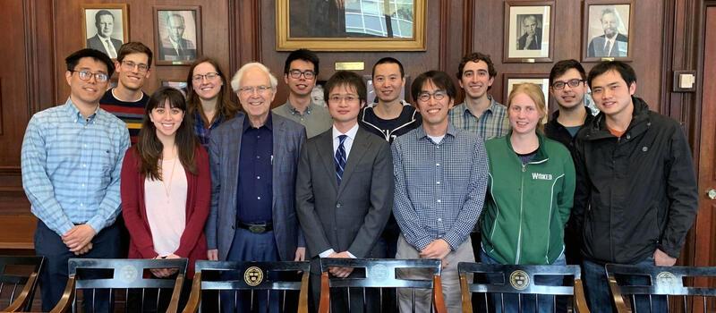 A group photo of 13 Gordon group members, including Professor Roy Gordon
