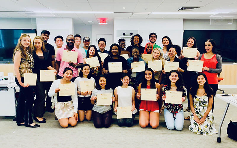 Participants in last year's Bridge to Dental School program pose with their certificates and HSDM mentors.