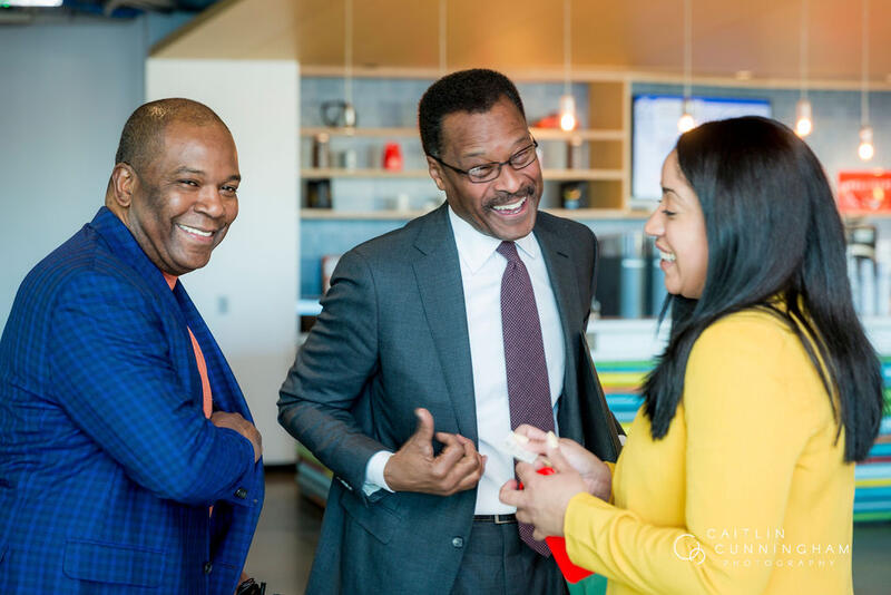 Featured speakers and DEI leaders from Boston at the hackathon greet each other. From right to left, Oris Stuart from the NBA, John Wilson from Harvard University, and Anna Ribeiro from Wellington Management.