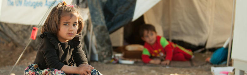 Girl sits in refugee camp