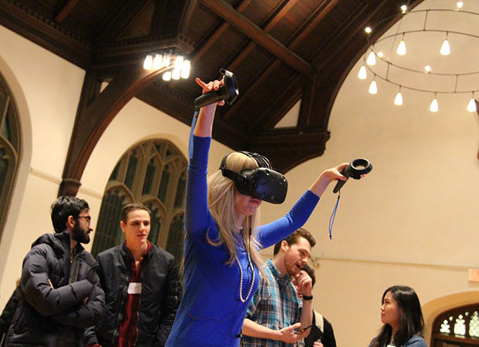 A user tries the Chi virtual reality experience during an event in Andover Chapel. Photo: Michael Naughton, HDS