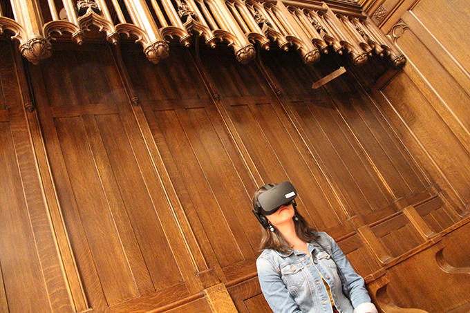 A user tries the When We Die virtual reality experience during an event in Andover Chapel. Photo: Michael Naughton, HDS