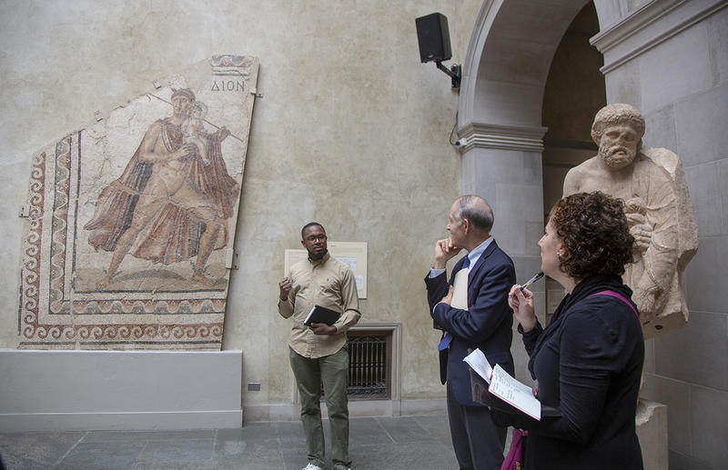 "Harvard PhD candidate Jeremy Williams discusses ""Hermes and Dionysos Floor Mosaic"" with James Welu, director emeritus of the Worcester Art Museum, and HDS Professor Laura Nasrallah. Photo by Julie Clack, Princeton University."