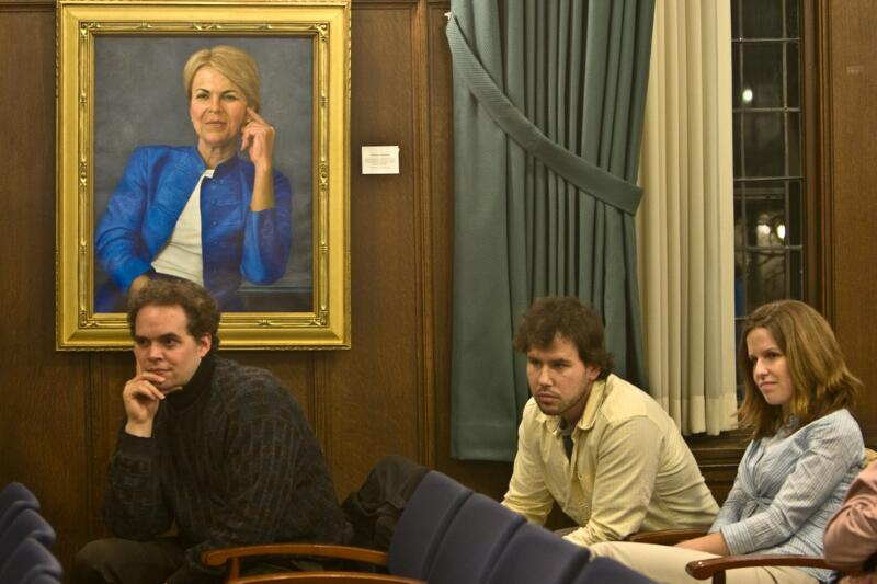 Students sitting in front of a portrait of Constance Buchanan