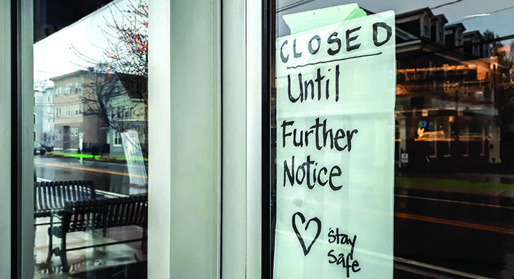 Stay Safe sign in window of closed store