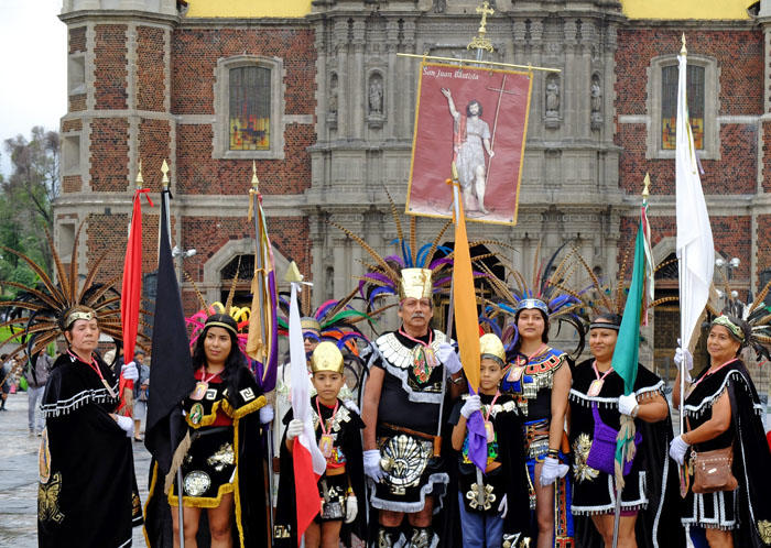 Worshipers in traditional dress hold a banner for St. John the Divine, Shrine of the Virgin of Guadalupe