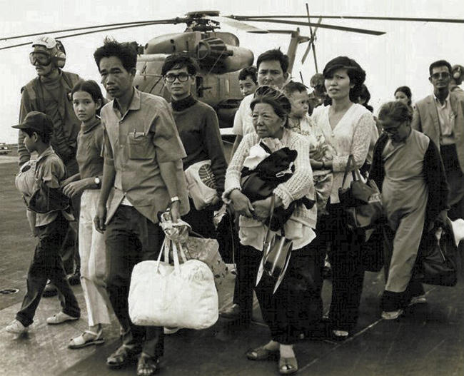 Refugees from Saigon, South Vietnam, boarding a US carrier