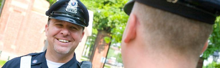Image of Smiling Police Officer on a Sunny Day