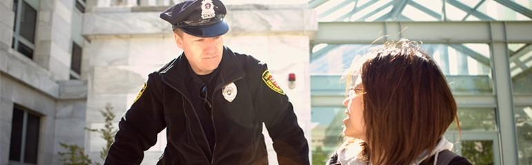 Image of Officer Helping a Student