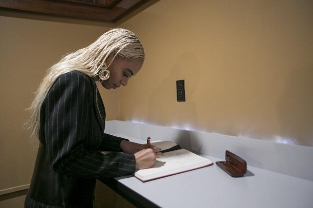 Solange Knowles signs the Harvard university guest book