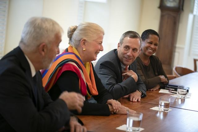 Brian Farrell, Margot Gill, Larry Bacow and Patti Bellinger in discussion with President Moreno at Massachusetts Hall