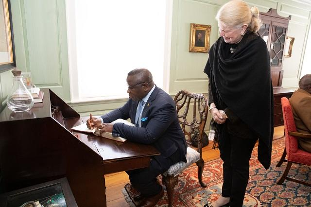 President Bio signs the university guest book at Wadsworth House