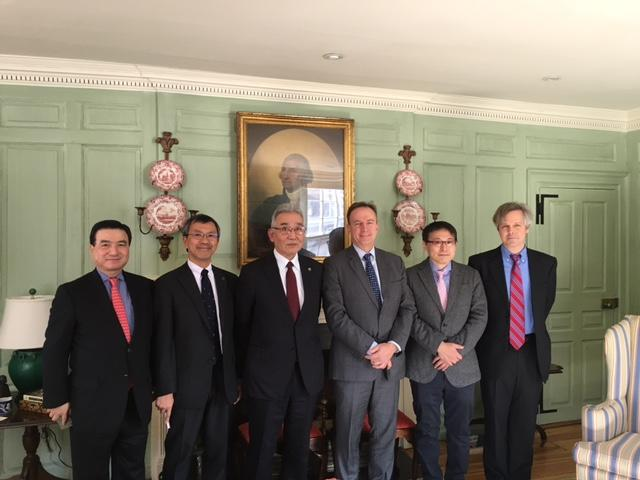 President Iwabuchi (center left) with Vice Provost Mark Elliott (center right) and colleagues in the Wadsworth House parlor