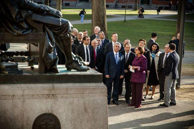 The President of Armenia with the University Marshal at the John Harvard statue