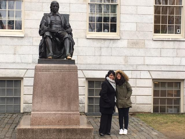 President Gurib-Fakim and her daughter at the John Harvard statue
