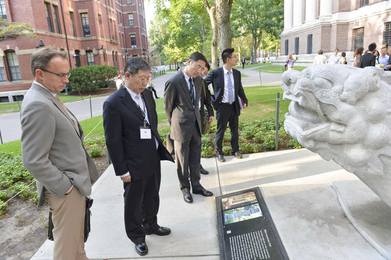 Vice Provost Elliott and Mayor Yang admire the Tercentenary Stele, presented to Harvard in 1936 as a gift from Chinese alumni on the occasion of the University's 300th anniversary.