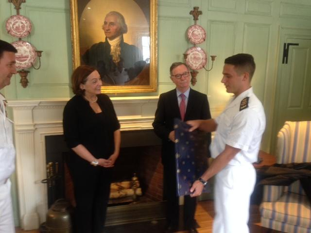 Jackie O'Neill is presented with a gift while the Spanish Consul General looks on