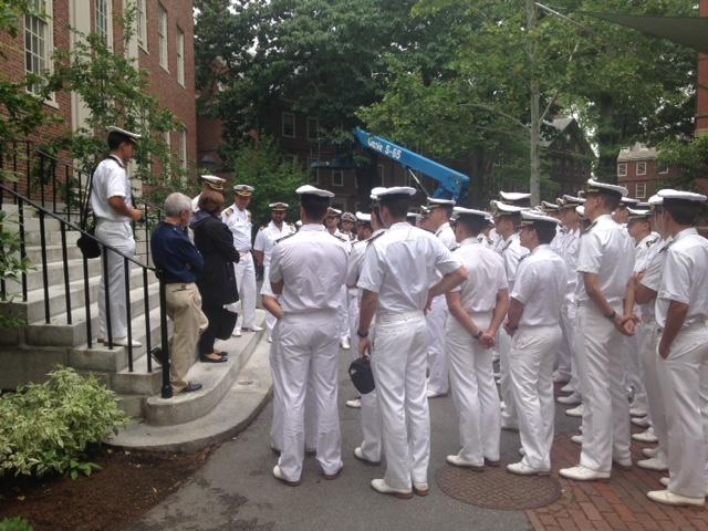Jackie O'Neill greets the naval officers outside of Dudley House, next to Wadsworth House.