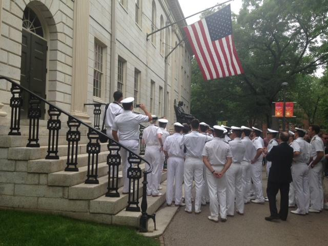 The Spanish naval officers conclude their tour at the John Harvard statue.