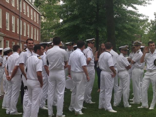 Undergraduate tour guide Abby Westover tells the naval officers about Harvard and Massachusetts Halls