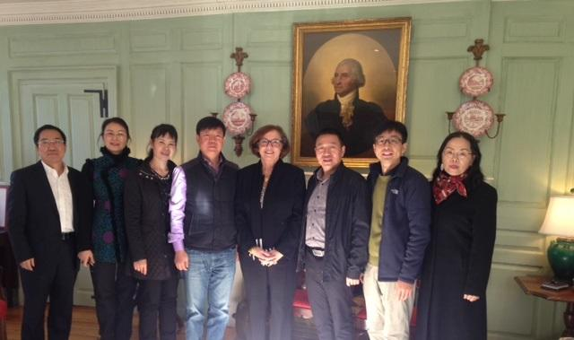 The Yunnan Normal University delegation in the Wadsworth House Parlor with the University Marshal