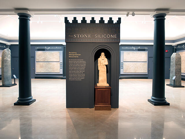 Gallery with statues and stele.