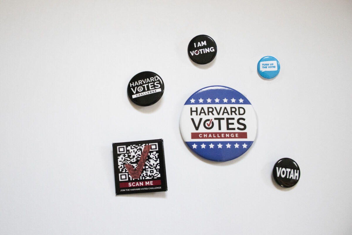 collection of pins written Harvard votes
