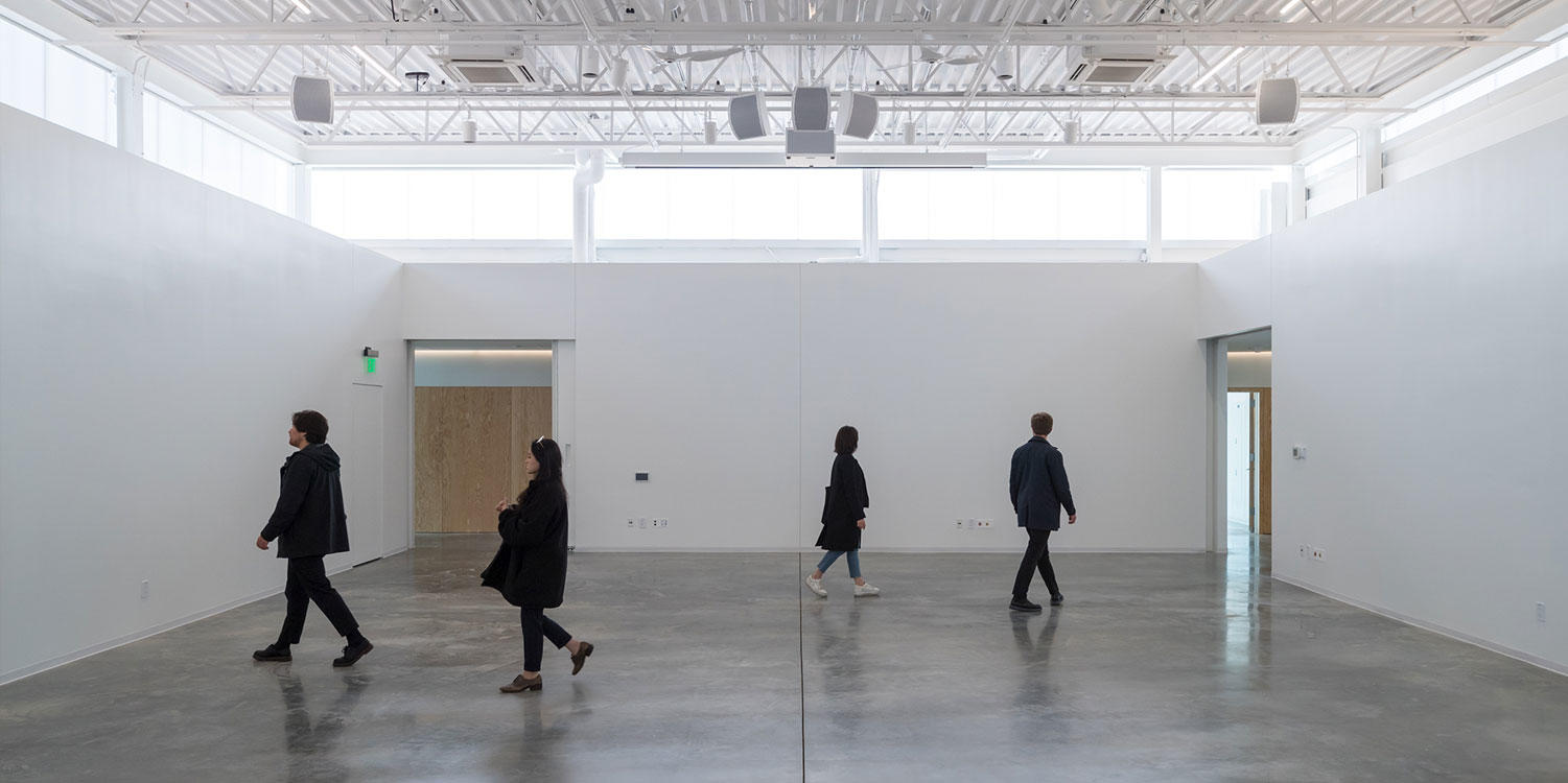 Students walking through the ArtLab building.