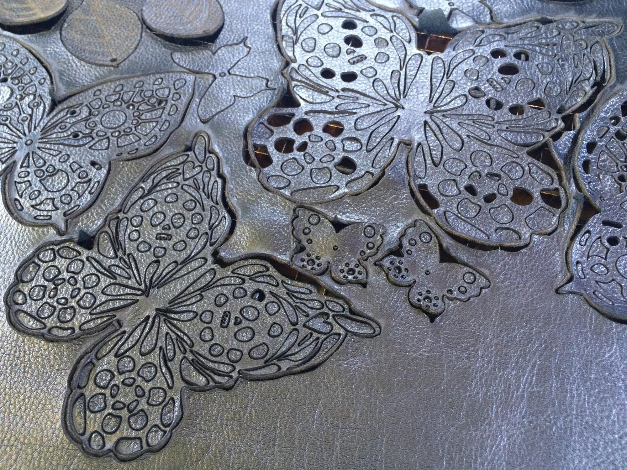 Butterfly designs in leather created from a laser cutter.