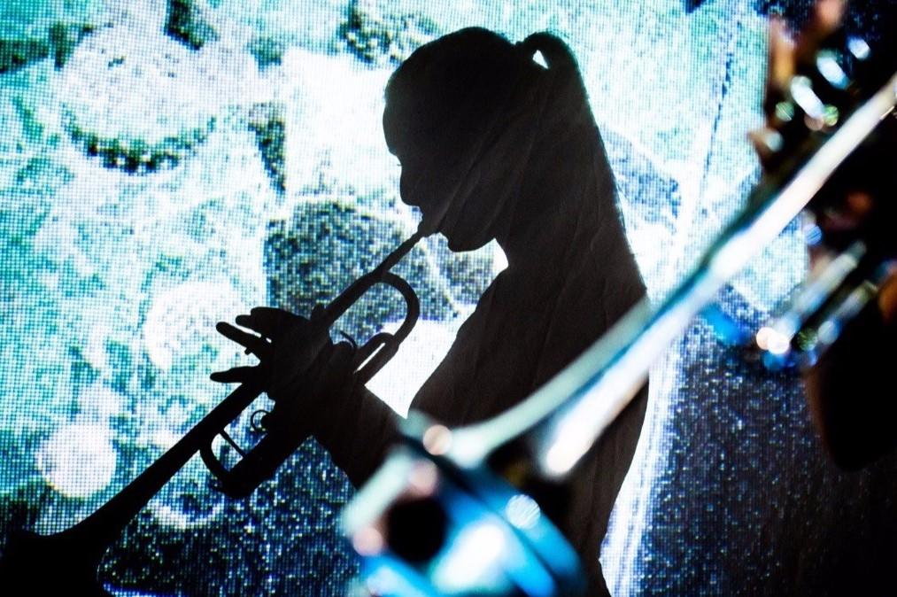 Image of Masary Studios Performer playing a trumpet