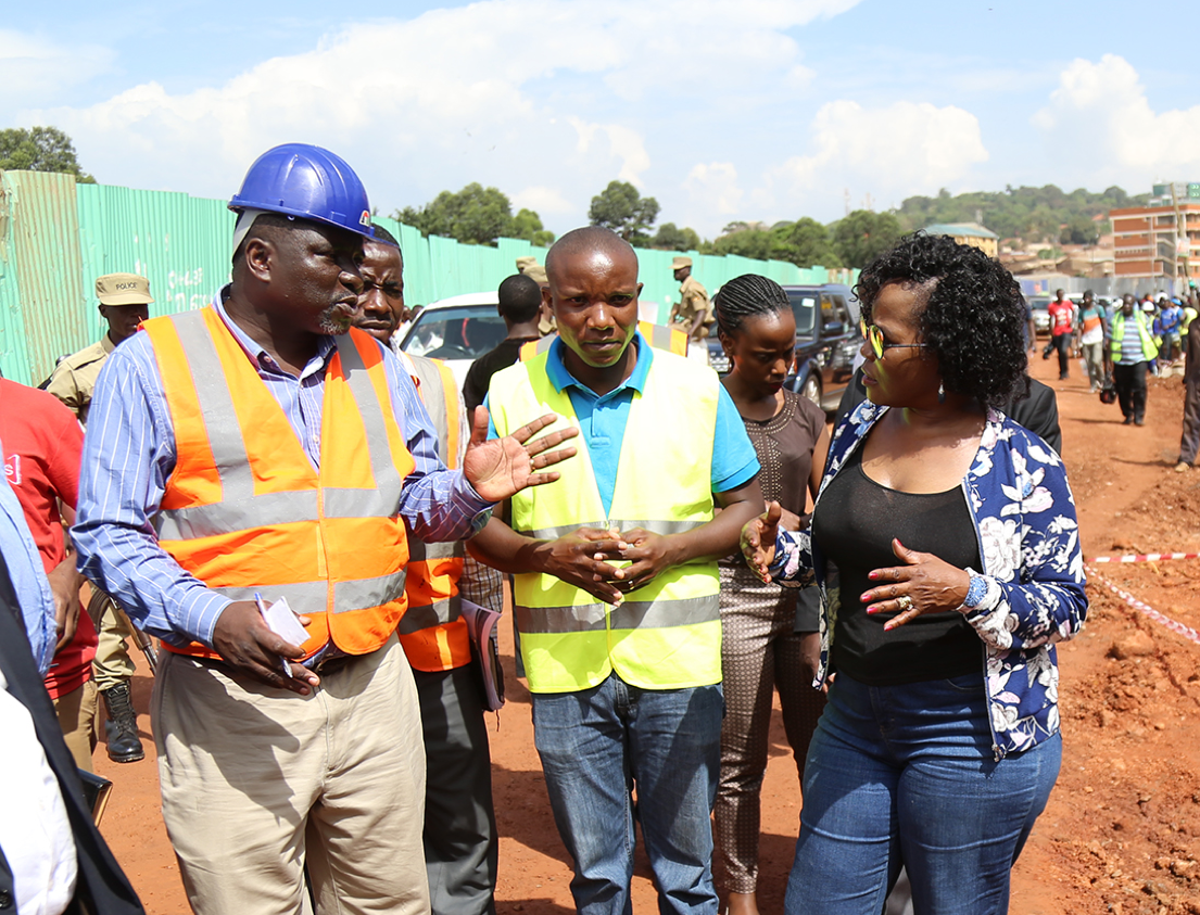 Musisi discussing public works