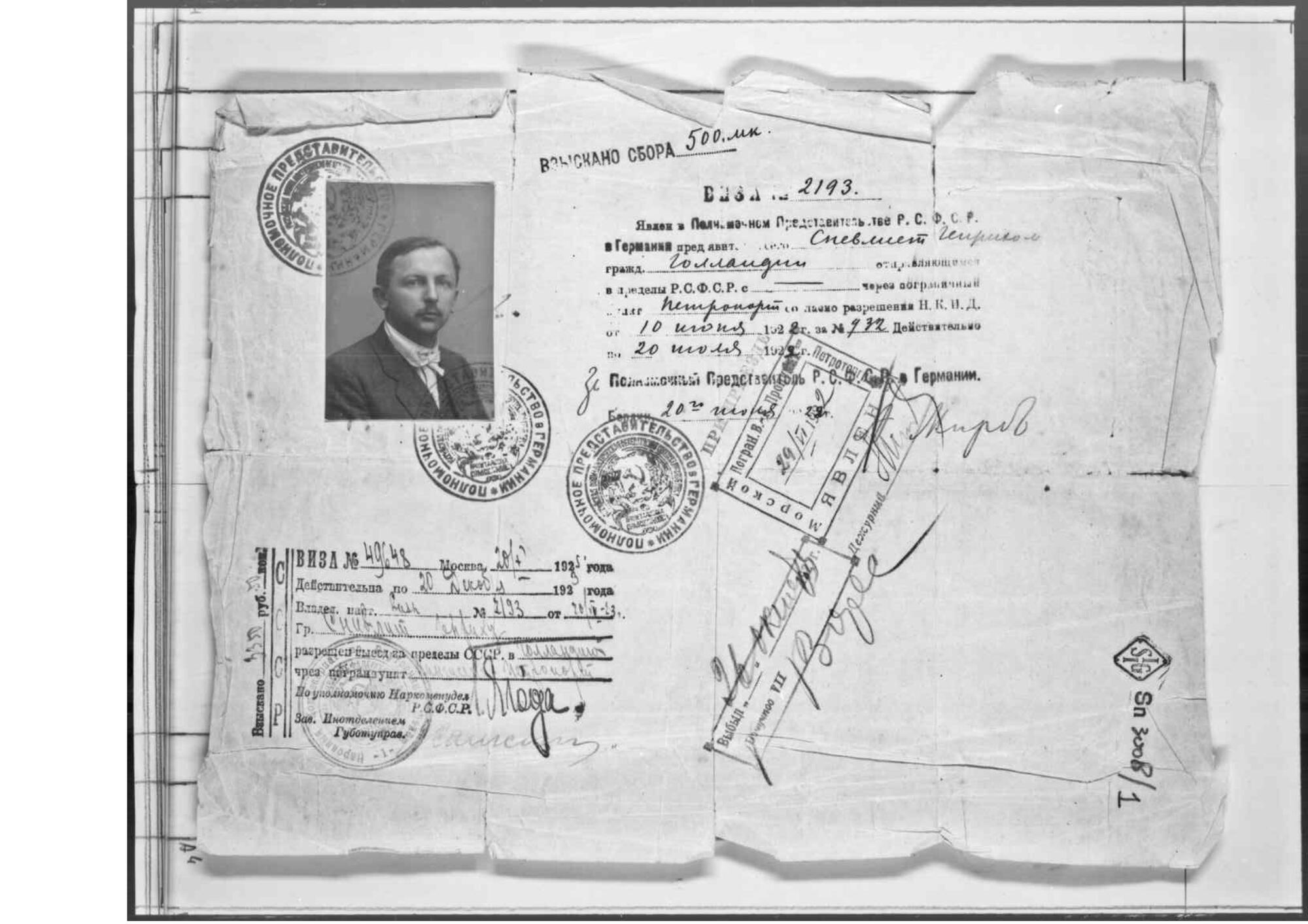 Scan of an old visa featuring a photo in the upper-left corner
