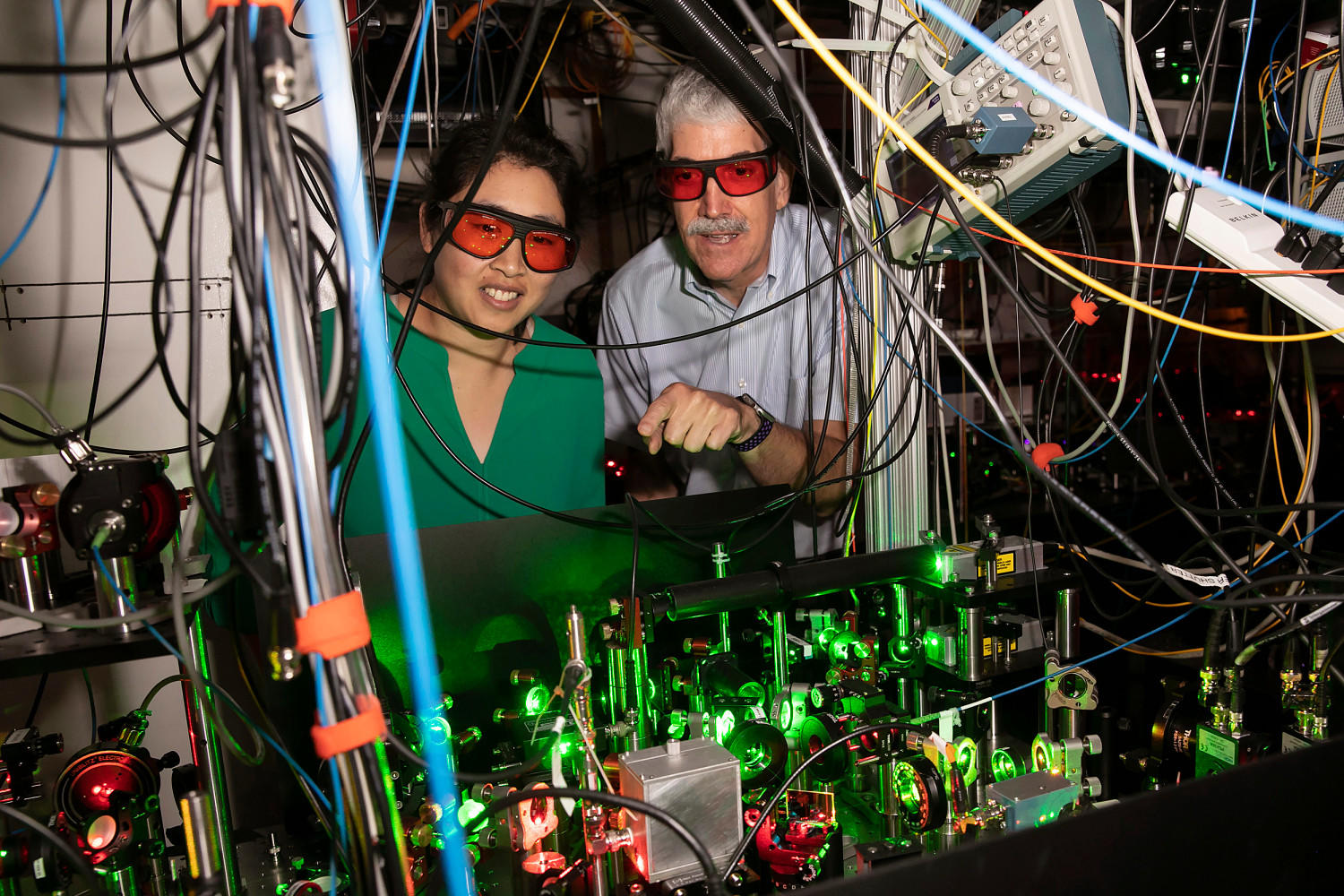 Kang-Kuen Ni (left) and John Doyle use precisely focused lasers as optical tweezers