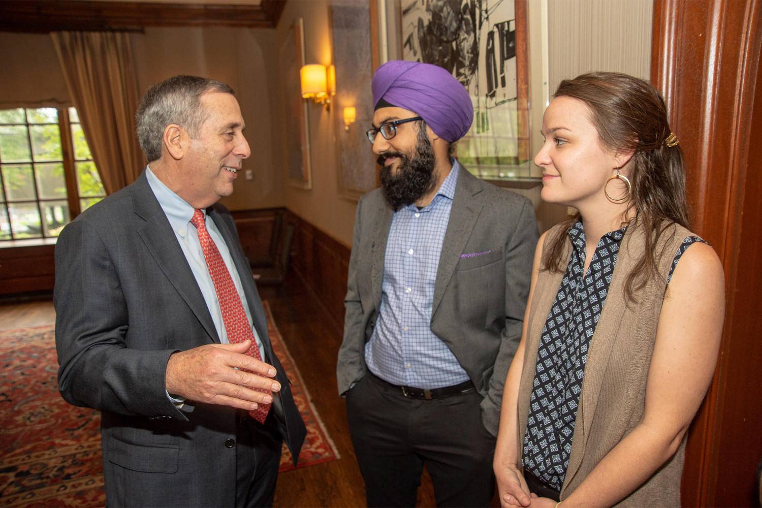 President Larry Bacow, Harmann Singh, and Sarah Bourland