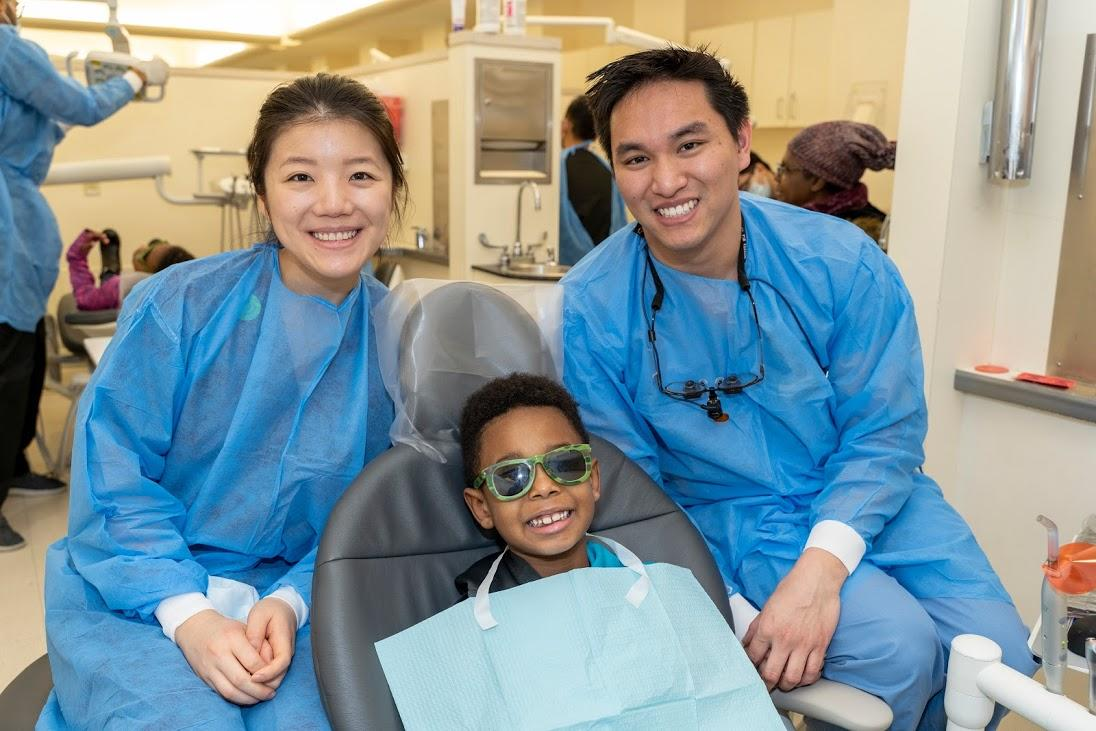 HSDM students administer care to a pediatric patient on Give Kids a Smile Day 2019
