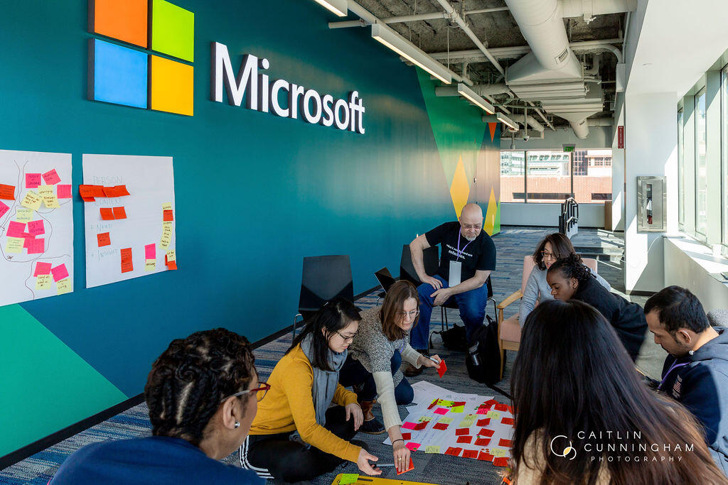 Hack for Inclusion participants convene at the Microsoft NERD Center to ideate solutions which advance equity in Boston, among them students, staff, faculty, and researchers from Harvard.
