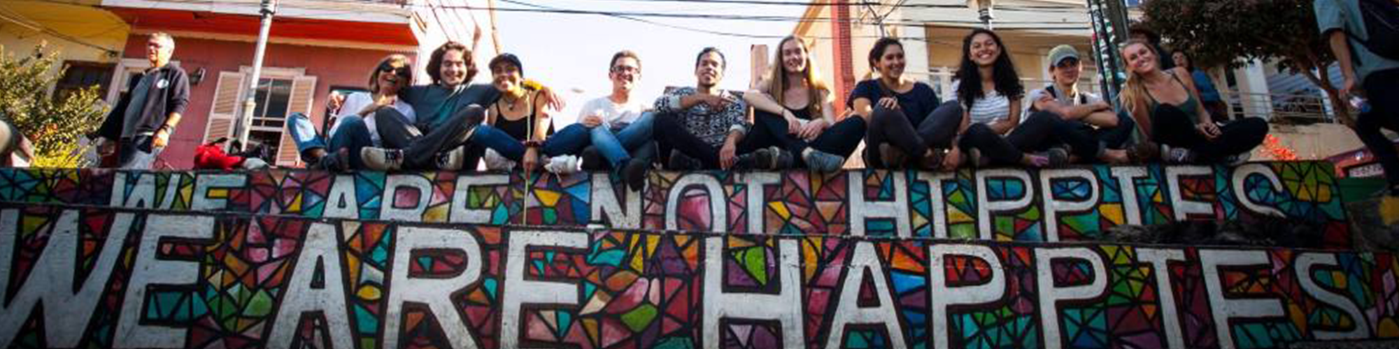 students sitting on a mural in Chile