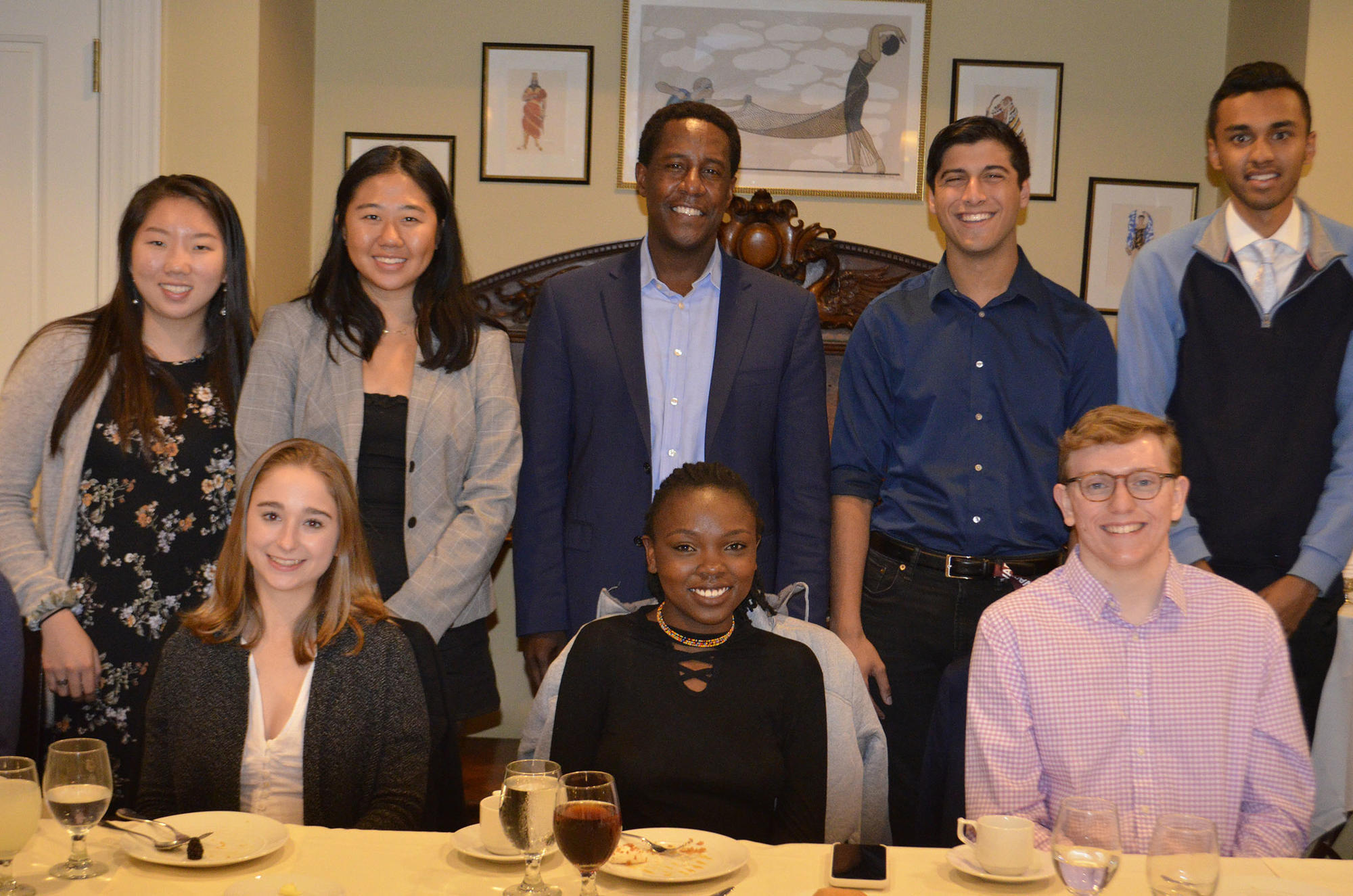 Students enjoy dinner with Setti Warren