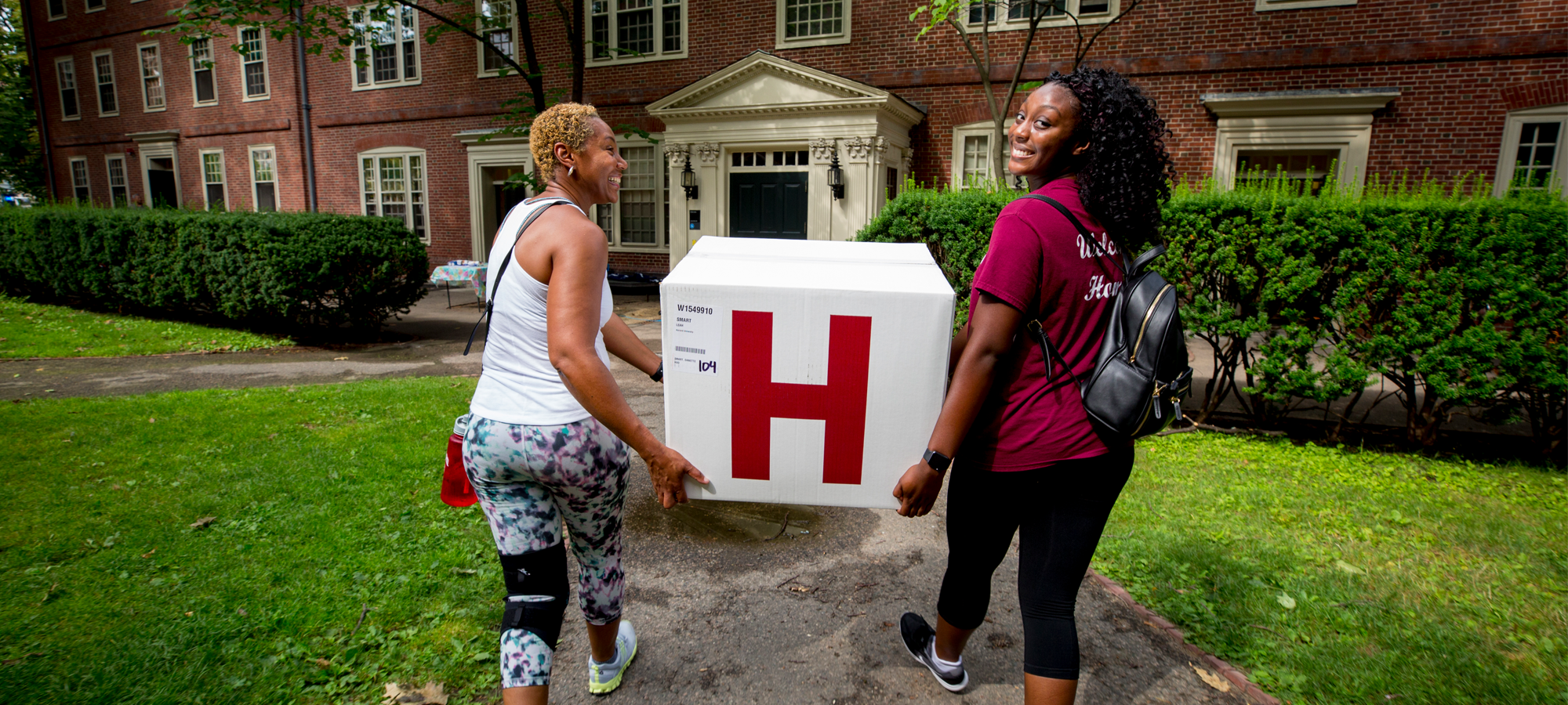 Leah Smart, (on right) has help from her Mom, Dee Smart to move into Straus Hall