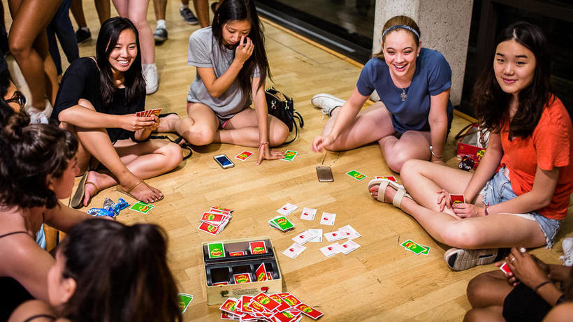 students playing a card game