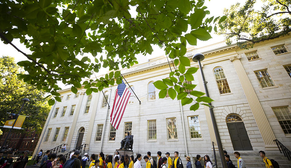 University Hall with tourists around the John Harvard statue