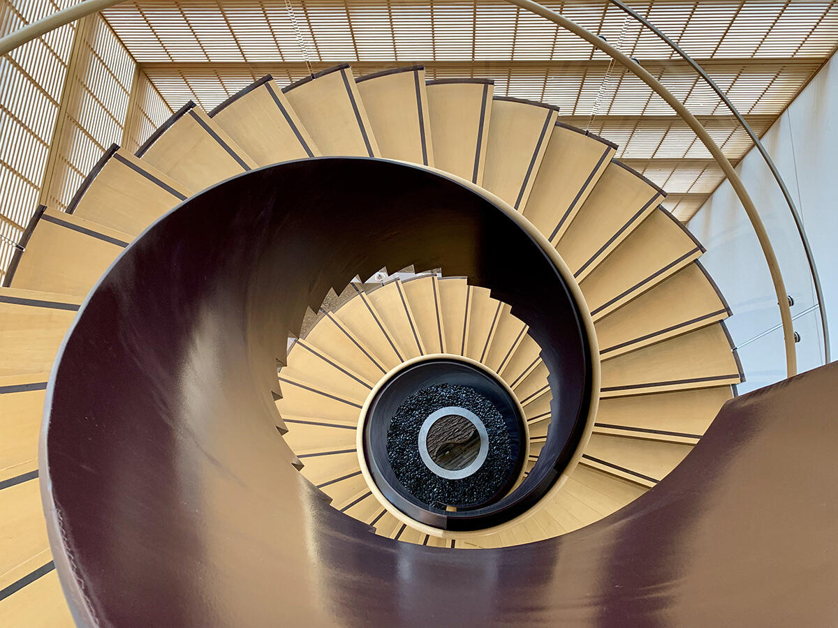 View of a spiral staircase from above.