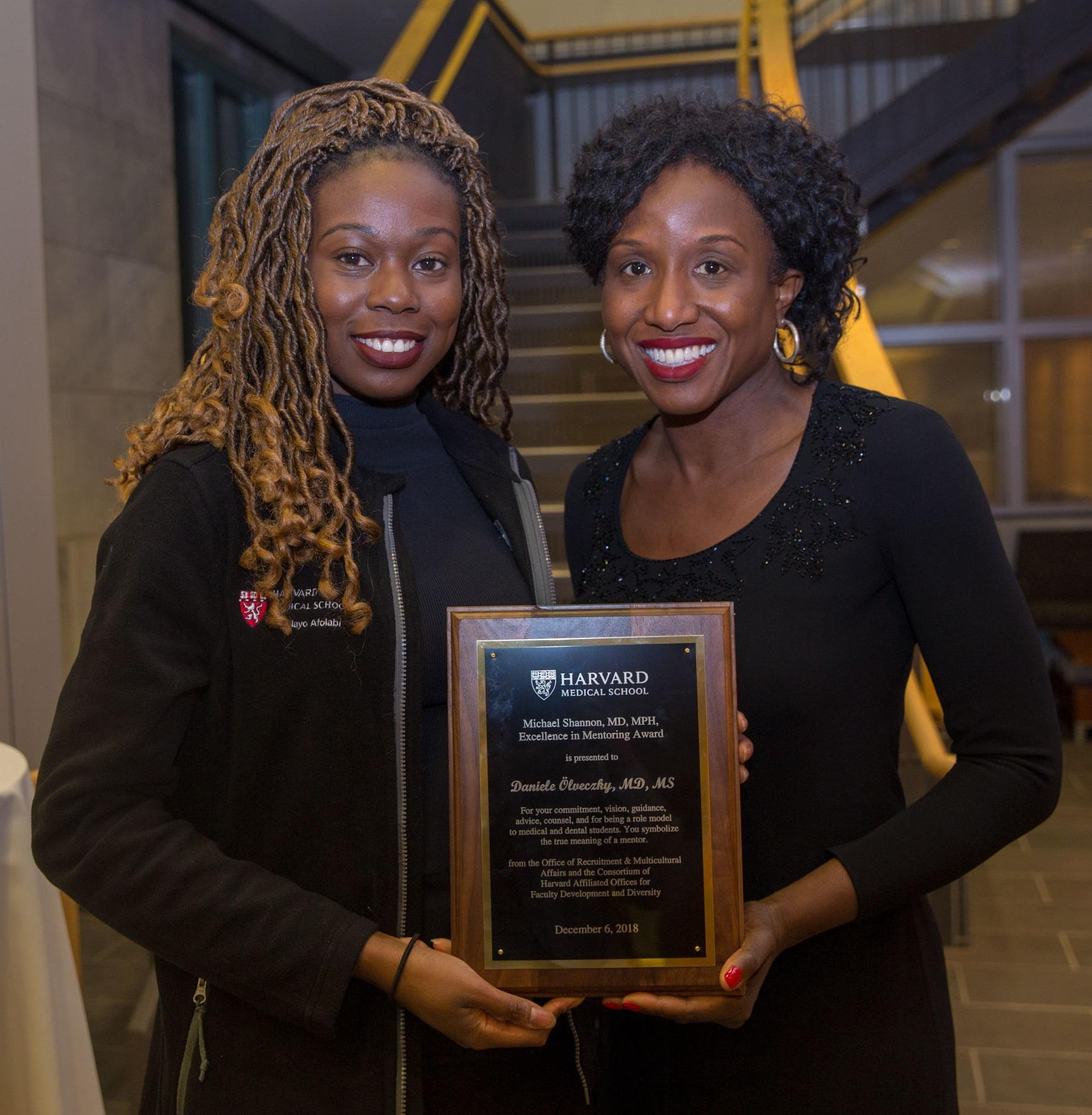 Titi Afolabi and Daniele Olveczky with award. Image: Bethany Versoy