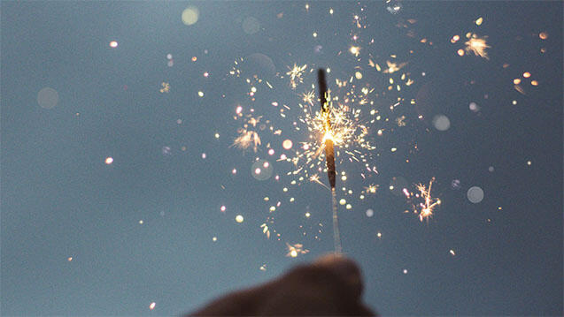 close-up of sparkler in a persons hand
