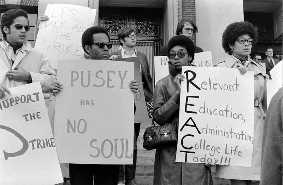 African American Harvard students holding placards during a protest against the Vietnam War and in support of a Black Studies curriculum at Harvard University in Cambridge, Massachusetts, April 1969